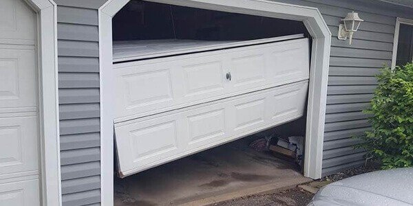 broken garage door Noble Garage Door & Gate Repair Highwood