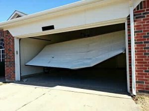 repair1 1 300x225 Should You Try To Repair Your Garage Door Yourself?