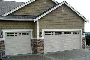steel garage door 1 1 300x200 Should You Try To Repair Your Garage Door Yourself?